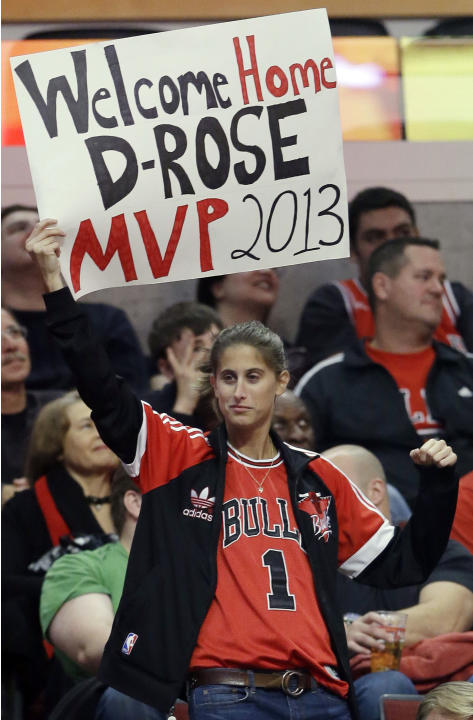 A Chicago Bulls fan holds a sign during the second half of an NBA preseason basketball game between the Detroit Pistons and the Chicago Bulls in Chicago on Wednesday, Oct. 16, 2013. The Bulls won 96-8