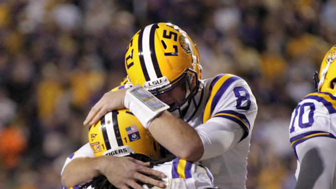 LSU running back Spencer Ware (11) celebrates his touchdown reception with quarterback Zach Mettenberger (8) in the first half of their NCAA college football game against Mississippi State in Baton Rouge, La., Saturday, Nov. 10, 2012. (AP Photo/Gerald Herbert)