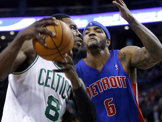 Detroit Pistons forward Josh Smith (6) closely guards the drive of Boston Celtics guard Jeff Green (8) to prevent Green from scoring with seconds to go in an NBA basketball game in Boston, Wednesday,