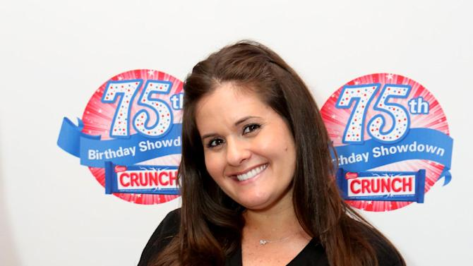 IMAGE DISTRIBUTED FOR NESTLE CRUNCH - Erica Tucker, owner of Sweet E's,  participates in the kick-off of the Nestle Crunch 75th Birthday Showdown at Sweet E's on Wednesday, March 27, 2013 in Los Angeles. (Photo by Casey Rodgers/Invision for Nestle Crunch/AP Images)