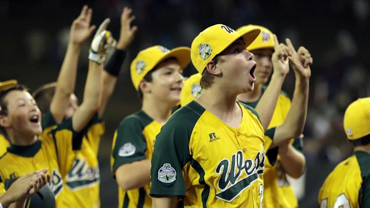 Petaluma, Calif.'s Bradley Smith, center right, reacts after California won a baseball game against San Antonio during the Little League World Series, Thursday, Aug. 23, 2012, in South Williamsport, Pa. California won 11-1. (AP Photo/Matt Slocum)