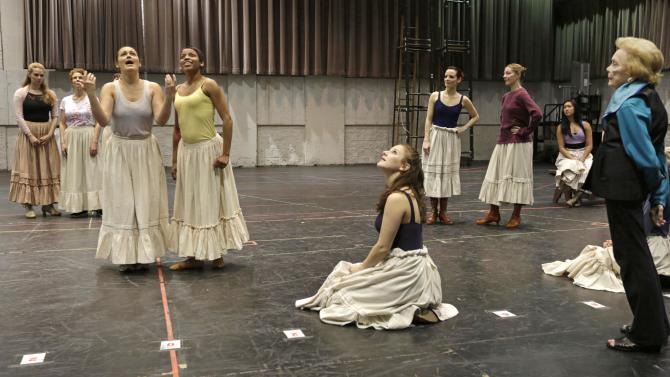 """In this April 26, 2013 photo, choreographer Gemze de Lappe, right, oversees a rehearsal of Rodgers and Hammerstein's """"Oklahoma!"""" at the Lyric Opera of Chicago. De Lappe first danced in """"Oklahoma!"""" in 1943 as a member of the Broadway hit's first national touring company and now 70 years later at age 91 she's choreographing a production of the musical at the Lyric. (AP Photo/M. Spencer Green)"""