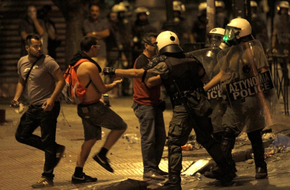 Protesters clash with riot police during a demonstration in Athens late Tuesday June 28, 2011. Greece's beleaguered government is bracing for a 48-hour general strike as lawmakers debate a new round of austerity reforms designed to win the country additional rescue loans needed avoid bankrup. (AP Photo/Petros Karadjias)
