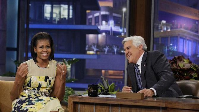 "This Monday, Aug. 13, 2012 photo released by NBC shows first lady Michelle Obama, left, and host Jay Leno during a taping of ""The Tonight Show with Jay Leno,"" in Burbank, Calif. (AP Photo/NBC, Margaret Norton)"