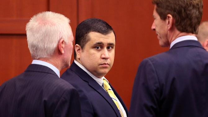 """George Zimmerman, defendant in the killing of Trayvon Martin, arrives with his attorney Mark O'Mara, right, for a pre-trial hearing, Tuesday, April 30, 2013 in Seminole circuit court, in Sanford, Fla.  Zimmerman, the former neighborhood watch leader,  told Circuit Judge Debra Nelson that he agrees with his defense attorneys' decision not to seek an immunity hearing under the state's """"Stand Your Ground"""" self-defense law.  Zimmerman has pleaded not guilty, claiming self-defense. Martin was fatally shot in February 2012 during a fight with Zimmerman in a Sanford gated community.  (AP Photo/Orlando Sentinel, Joe Burbank, Pool)"""