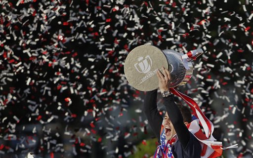 Atletico de Madrid's Gabi Fernandez holds the trophy in Neptuno Square in Madrid, Spain, Saturday, May 18, 2013. Atletico de Madrid defeated Real Madrid in the Copa del Rey final soccer match on Frida