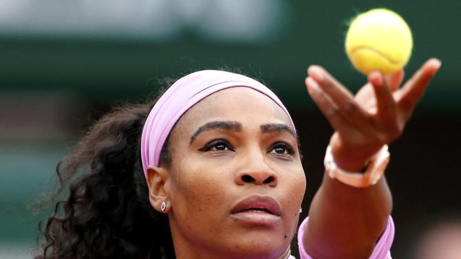 Serena Williams of the U.S. serves to Andrea Hlavackova of the Czech Republic during their women's singles match at the French Open tennis tournament at the Roland Garros stadium in Paris