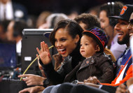 FILE - In this Nov. 2, 2012 file photo, singer Alicia Keys, left, her son Egypt and her husband Swizz Beatz, right, watch courtside during an NBA basketball game between the New York Knicks and the Miami Heat, in New York. Keys is releasing her fifth album, &quot;Girl on Fire,&quot; on Nov. 27, 2012. It features Frank Ocean, Bruno Mars, Babyface, Emeli Sande, Maxwell, Nicki Minaj, John Legend, her husband Swizz Beatz and their son Egypt. (AP Photo/Jason DeCrow, File)