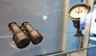 NEW YORK, NY - JANUARY 05:  Binoculars (L) and a logometer, used to measure boat speed, are seen among artifacts recovered from the RMS Titanic wreck site at a press preview of a Titanic artifact auction at the Intrepid Sea, Air & Space Museum on January 5, 2012 in New York City. On April 11, 2012, the 100th anniversary of the maiden voyage of the Titanic, Guernsey&#39;s will auction the complete collection of more than 5,000 artifacts recovered from the Titanic wreck site.  (Photo by Mario Tama/Getty Images)