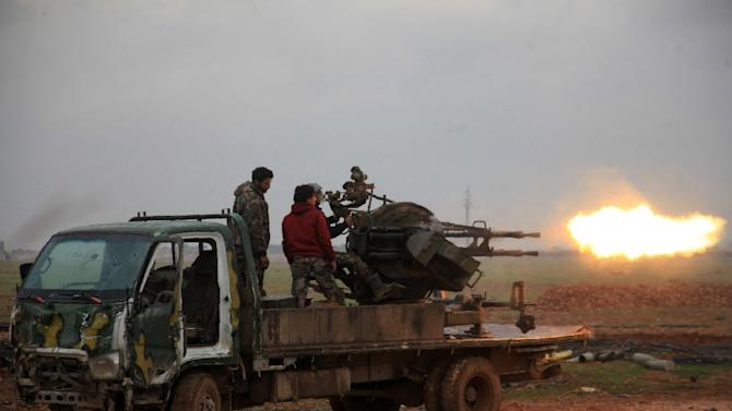 Syrian regime forces fire towards Islamic State (IS) jihadists south of the town of Al-Bab, in the northern province of Aleppo on January 14, 2016