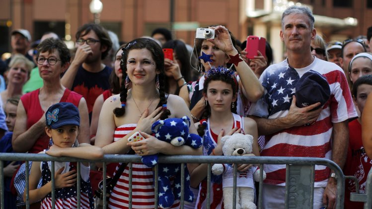 The Haig family stands for the United States pledge of allegiance before a public reading the United States Declaration of Independence, part of Fourth of July Independence Day celebrations, in Boston