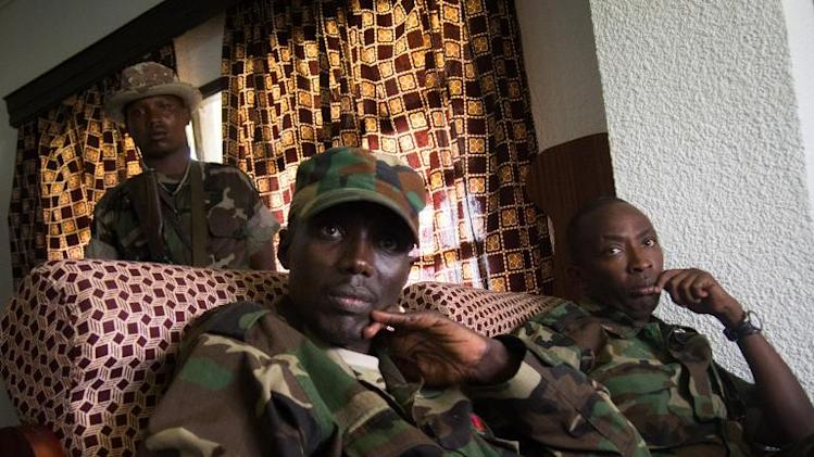 The military chief of Democratic Republic of Congo's M23 rebels, Sultani Makenga (2nd L), is seen in Bunagana, near the Ugandan border, on March 2, 2013