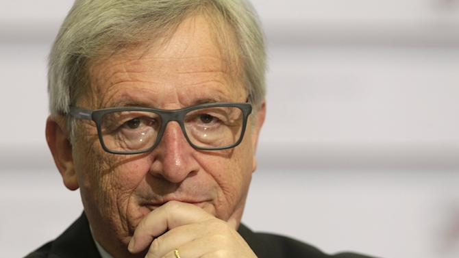 European Commission President Juncker gestures as he looks on before the Eastern Partnership Summit session in Riga