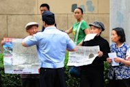 <p>Elderly petitioners protesting about land grab issues are detained by police in Beijing in May 2012. China has seen widespread urban demolition and conversion of rural land for housing over the past few decades, as the economy has grown and cities have dramatically expanded during a period of rapid economic growth.</p>