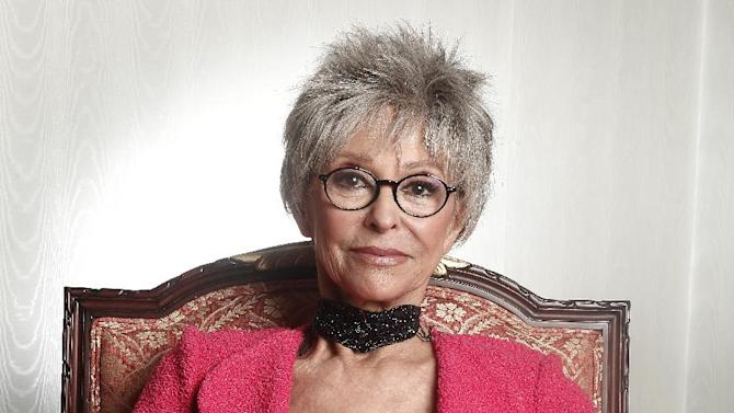 "FILE - In this March 6, 2012 file photo, actress Rita Moreno poses for a portrait at the Waldorf Astoria Hotel in New York. Moreno will receive SAG-AFTRA's Life Achievement Award for career achievement and humanitarian accomplishment at the 2014 Screen Actors Guild Awards. SAG-AFTRA Co-President Ken Howard said the 81-year-old actress is the 50th recipient of the award, ""the most prestigious honor we bestow."" (AP Photo/Carlo Allegri, File)"