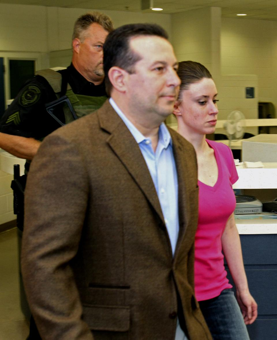 Casey Anthony, front right, walks out of the Orange County Jail with her attorney Jose Baez, left,  during her release in Orlando, Fla., Sunday, July 17, 2011.  Anthony was acquitted last week of murder in the death of her daughter, Caylee. (AP Photo/Red Huber,Pool)