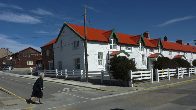 In this March 6, 2012 photo, Daisy Rowlands crosses a street in Stanley, Falkland Islands. Rowlands' great-great grandfather James Watson was one of the earliest British settlers of the Falklands, arriving in 1839. Census results show zero population growth in the Falkland Islands. A survey in April found just 2,563 residents, a term that excludes civilian contractors and British military personnel. That's basically the same population as six years ago. (AP Photo/Michael Warren)