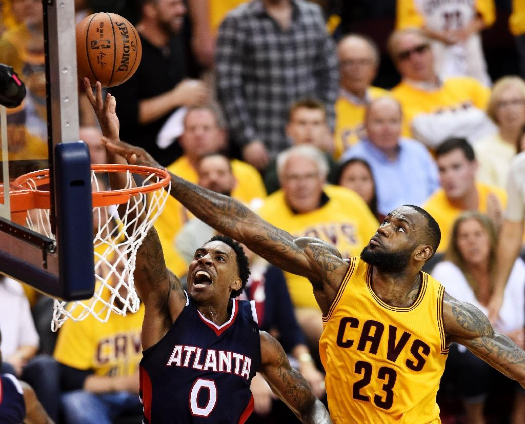 LeBron, Cavs survive Hawks in OT, now one win away from NBA Finals