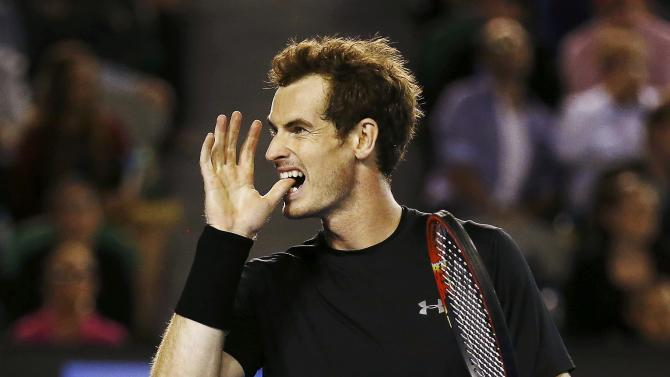 Murray of Britain reacts after hitting a shot to Berdych of Czech Republic during their men's singles semi-final match at the Australian Open 2015 tennis tournament in Melbourne