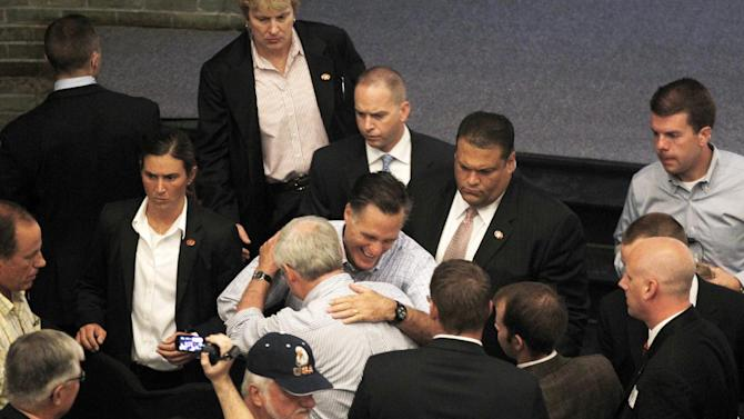 Republican presidential candidate, former Massachusetts Gov. Mitt Romney hugs a supporter as he campaigns at Central Campus High School in Des Moines, Iowa, Wednesday, Aug. 8, 2012. (AP Photo/Charles Dharapak)