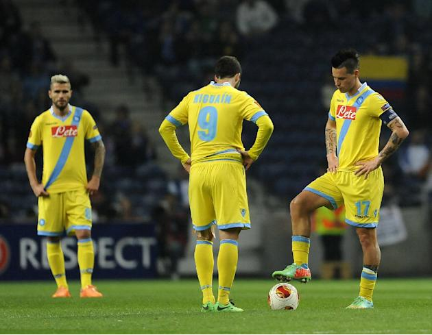 Napoli's Marek Hamskik, right, Gonzalo Higuain, center, and Valon Behrami, left, react after a goal from FC Porto during their Europa League round of 16, first leg soccer match at the Dragao stadi