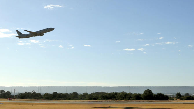 A U.S. Navy P8 Poseidon takes off from Perth Airport en route to rejoin the ongoing search operations for missing Malaysia Airlines Flight 370 in Perth, Australia, Sunday, April 13, 2014. Military planes and ships from seven nations continue to scour the Indian Ocean off the coast of western Australia for Flight 370 in one of the largest maritime multi-nation searches in history. (AP Photo/Rob Griffith)
