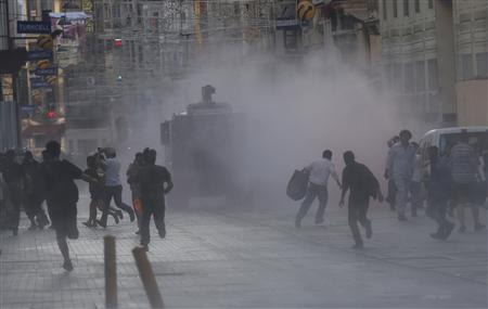 Riot police use a water cannon to disperse protesters in central Istanbul