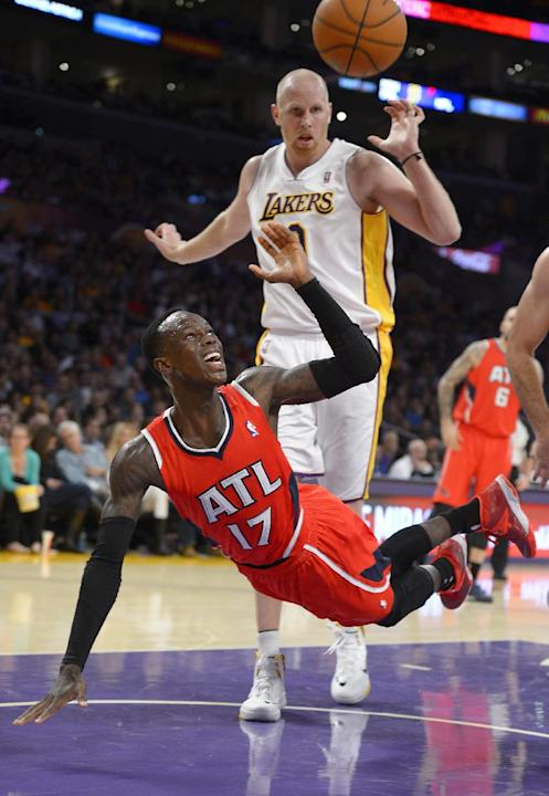 Atlanta Hawks guard Dennis Schroder, of Germany,, below, puts up a shot as Los Angeles Lakers center Chris Kaman defends during the second half of their NBA basketball game, Sunday, Nov. 3, 2013, in L