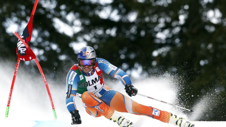 Svindal of Norway clears a gate during the first run in the men's World Cup giant slalom skiing race in Alta Badia