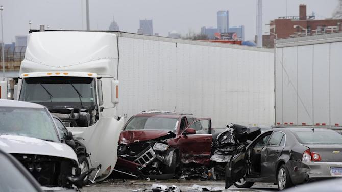 A section of multi-vehicle accident on Interstate 75 is shown in Detroit, Thursday, Jan. 31, 2013. Snow squalls and slippery roads led to a series of accidents that left at least three people dead and 20 injured on a mile-long stretch of southbound I-75. More than two dozen vehicles, including tractor-trailers, were involved in the pileups. (AP Photo/The Detroit News, David Coates)