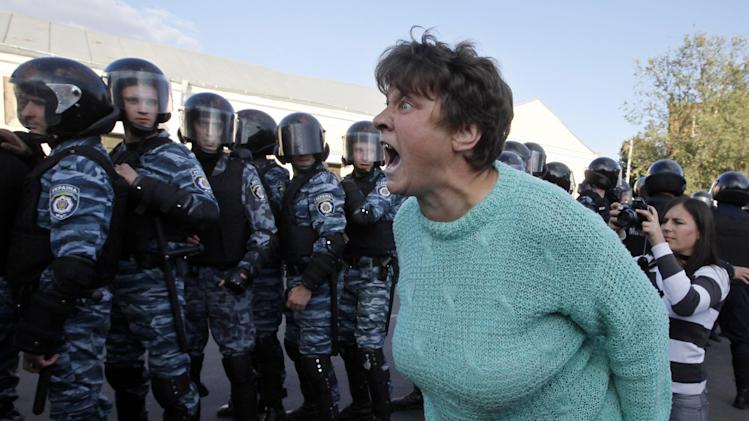 A woman argues at riot police officers during a rally of protest against pilgrimage of Hassidic Jews in the town of Uman, 200 kilometers (125 miles) south of Ukraine's capital Kiev, Sunday, Sept. 25, 2011.  Some 30,000 Hasidic Jews from around the world are expected in Uman next week to mark the Jewish New Year, or Rosh Hashana, at the tomb of Rabbi Nachman, the great grandson of the founder of Hasidism. (AP Photo/Efrem Lukatsky)