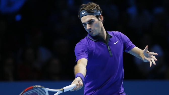 Roger Federer of Switzerland plays a return to Noak Djokovic of Serbia during their ATP World Tour Tennis singles final match in London, Monday, Nov.  12, 2012. (AP Photo/Kirsty Wigglesworth)