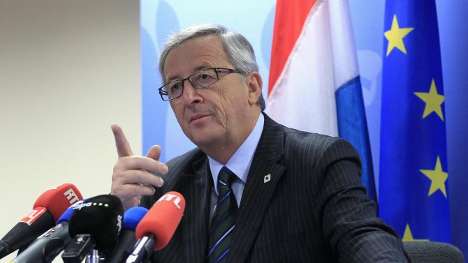 File photo of Luxembourg's then PM Juncker holding a news conference after a European Union leaders summit in Brussels