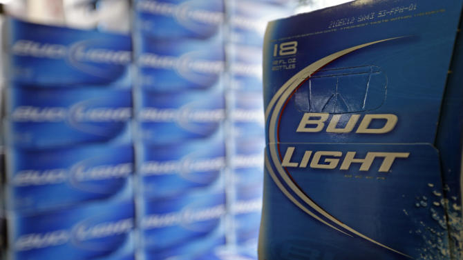 Budweiser maker AB InBev reports lower profit