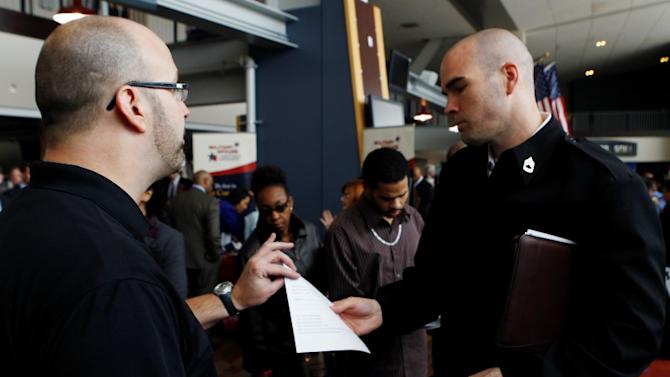 David Wallace of Lockheed Martin interviews an applicant at a job fair held by the U.S. Chamber of Commerce and the Washington Nationals baseball club in Washington