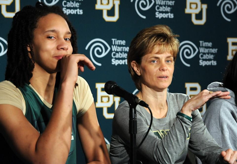 Baylor's  Brittney Griner, left, listens as head coach Kim Mulkey, right,  speaks during a news conference in Waco, Texas, Thursday, March 29, 2012. Baylor will play Stanford  in an NCAA tournament Final Four semifinal college basketball game on Sunday. (AP Photo/Waco Tribune Herald, Rod Aydelotte)
