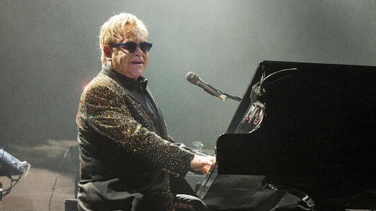 FILE - In this Nov. 30, 2013 file photo, Sir Elton John performs at the Allstate Arena in Rosemont, Ill. Organizers announced the lineup which includes John and Kanye West for this year's Bonnaroo Music and Arts Festival on Wednesday, Feb. 19, 2014. The four-day event begins June 12 in Manchester, Tenn. (Photo by Barry Brecheisen/Invision/AP, File)