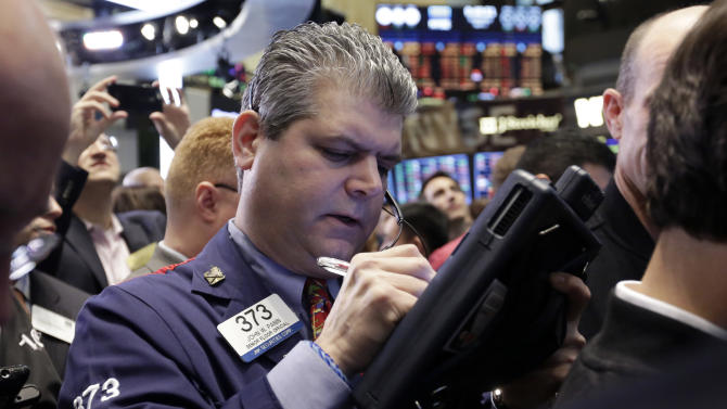 Trader John Panin works on the floor of the New York Stock Exchange, Wednesday, April 1, 2015. U.S. stocks moved lower in early trading Wednesday, extending losses from the day before. A report indicating that U.S. businesses slowed their pace of hiring last month weighed on the market. (AP Photo/Richard Drew)