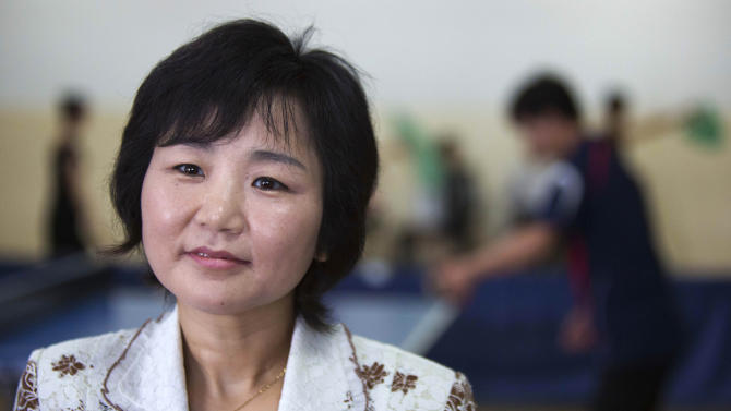 """In this June 13, 2012 photo, North Korean Li Pun Hui speaks to media at the Taedonggong Cultural Center for the Disabled in Pyongyang, North Korea. Putting aside politics, the intensely competitive Li paired up with her arch rival, South Korean star Hyun Jung-hwa, in 1991 as part of the first """"unified Korea"""" team to march into international competition wearing the flag of the Korean Peninsula. (AP Photo/David Guttenfelder)"""
