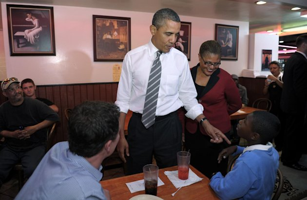President Barack Obama stops for a snack at Roscoe&#39;s House of Chicken and Waffles in Los Angeles, Monday, Oct. 24, 2011. Obama, who was joined by Rep. Karen Bass, D-Calif., is on a three-day trip to the West Coast. (AP Photo/Susan Walsh)