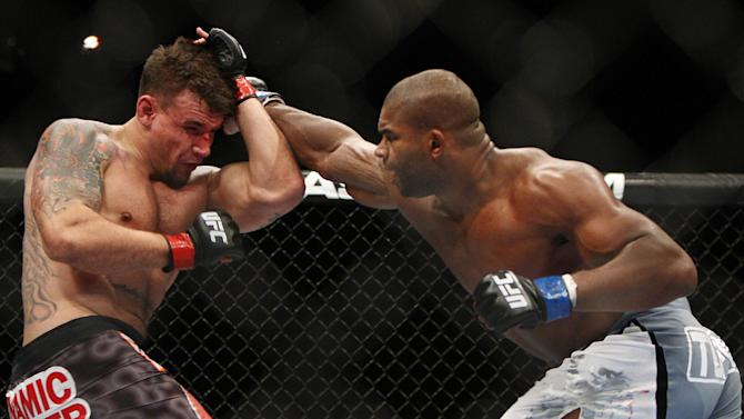 Frank Mir, left, and Alistair Overeem, of the Netherlands, fight during the second round of a UFC 169 heavyweight mixed martial arts bout in Newark, N.J., Saturday, Feb. 1, 2014. Overeem won by unanimous decision