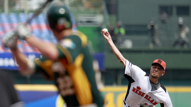 The Netherlands' starter Rob Cordemans delivers a pitch against Australia's third baseman Stefan Welch in the first inning of their World Baseball Classic first round game at the Intercontinental Baseball Stadium in Taichung, Taiwan, Tuesday, March 5, 2013. The Netherlands won 4-1. (AP Photo/Wally Santana)
