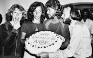 In this March 6, 1979, file photo, Andy Gibb eats a cherry from his birthday cake at a party given by his family in his home in Miami Beach, Fla. A representative said on Sunday, May 20, 2012, that Gibb has died. He was 62. (AP Photo/File)