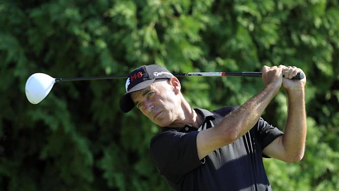 Corey Pavin drives on the sixth hole during the first round at the U.S. Senior Open golf tournament at the Indianwood Golf and Country Club in Lake Orion, Mich., Thursday, July 12, 2012. (AP Photo/Carlos Osorio)