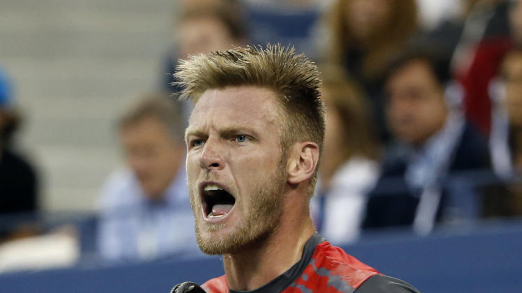 Sam Groth, of Australia, reacts after winning a point against Roger Federer, of Switzerland, during the second round of the U.S. Open tennis tournament Friday, Aug. 29, 2014, in New York. (AP Photo/Jason DeCrow)