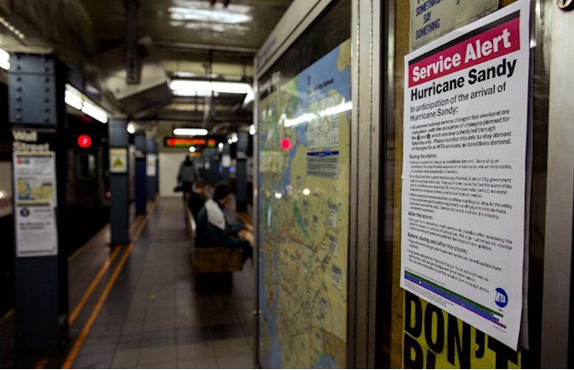 A sign informs subway riders of changes in service in the hours before the arrival of Hurricane Sandy in New York Sunday, Oct. 28, 2012. Areas in the Northeast Region prepared Sunday for the arrival o