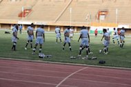 Members of the Bafana Bafana, South African national football team, warm up during a training session in Niamey. Thomas Madigage, assistant coach to South Africa's national football team Bafana Bafana, died in a car crash late