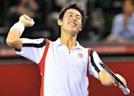 Kei Nishikori of Japan celebrates his win over Tomas Berdych of the Czech Republic during their quarter-finals match at the Japan Open tennis tournament in Tokyo on October 5. Nishikori made history by becoming the first Japanese player to win the Japan Open tennis tournament since 1972 when he defeated young Canadian star Milos Raonic in the final