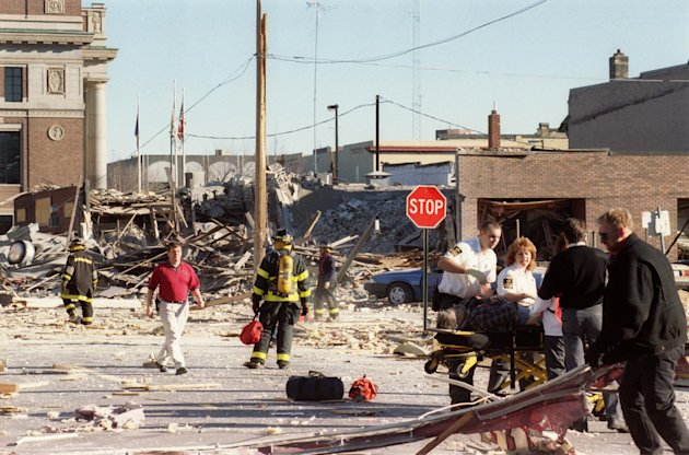 In this Dec. 11, 1998 photo, emergency personnel helping a victim of a gas explosion that killed four and leveled six buildings in downtown St. Cloud, Minn. An Associated Press investigation has found since 1968, there have been at least 270 natural gas accidents in the U.S. that could have been prevented or made less dangerous by an inexpensive valve that cuts off leaking gas. At least 67 people have been killed and more than 350 hurt. Yet nearly 90 percent of the nation's gas service lines aren't fitted with the valves. (AP Photo/The St. Cloud Times)