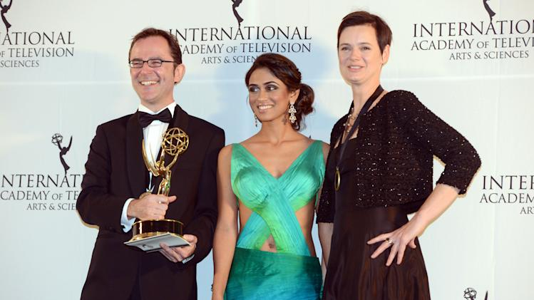 "Tristan Chytroschek, left, Susanne Mertens, right, of Germany pose with presenter Prerna Wanvari after winning the Arts Programming award for ""Songs of War"" at the 40th International Emmy Awards,  Monday, Nov. 19, 2012 in New York. (AP Photo/Henny Ray Abrams)"
